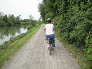 Brenda Biking Down The Canal Path Towards The Town Of Spencerport, NY