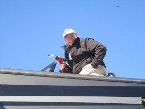 David On Roof Doing Maintenance.