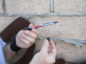 Cache (Magnetized To A Metal Sign) In David's Right Hand Compared To The Size Of A Pen