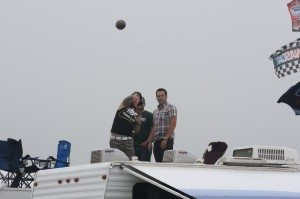 A Guy Throwing A Football At People