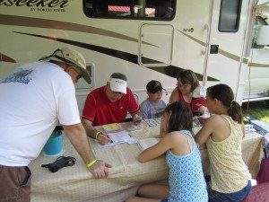 Everyone Gathered Around The Table, Coming Up With A Plan For Geocaching.