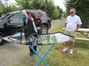 The New Seal Being Put On The New Windshield
