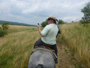 David Looking At The Text He Received While On The Horse Tour