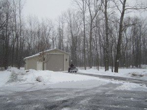 David Plowing The Driveway In Front Of The RV Garage