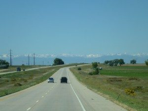 The Mountains Are Visible In The Background As You Drive Into Denver
