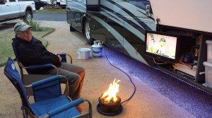 David Watching Football By The Campfire