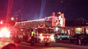 Santa And Mrs Clause On The Fire Truck Bucket